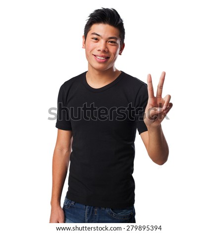 chinese man doing a victory sign - stock photo