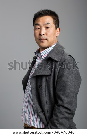 chinese man, he was a kind father was also a rigorous leadership - stock photo