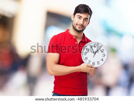 chinese man holding clock