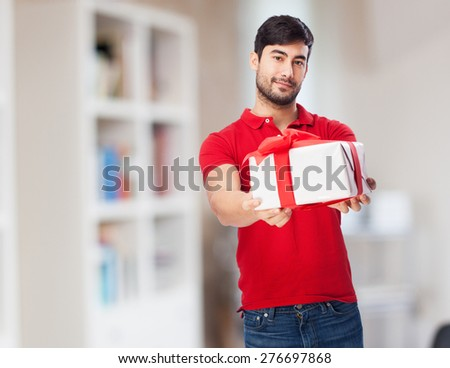 chinese man holding gift - stock photo