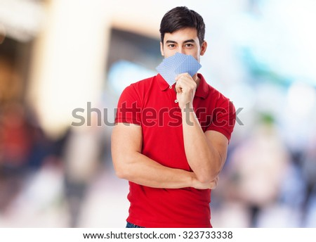 chinese man holding poker cards - stock photo