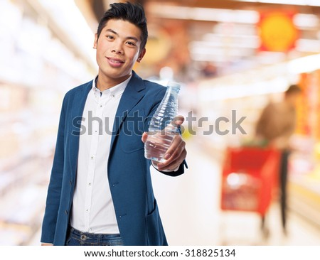 chinese man holding water - stock photo