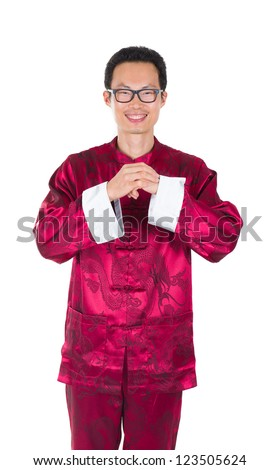 chinese man in traditional suit in chinese greeted isolated in white - stock photo