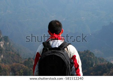 Chinese man standing on one of peaks of Wudang mountains, China