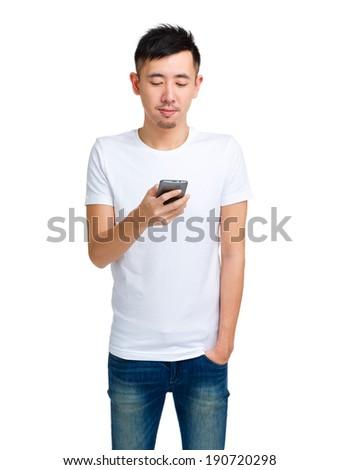 Chinese man using smartphone - stock photo