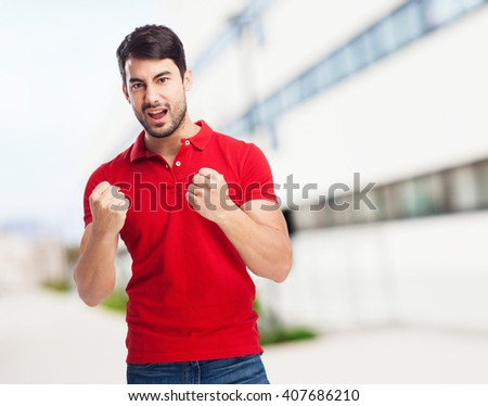 chinese man winner gesture - stock photo