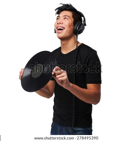 chinese man with headphones and vinyl