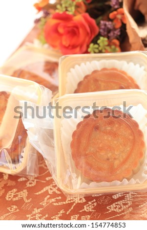 Chinese Mid-Autumn festival, Traditional confectionery Moon Cake with flower on background