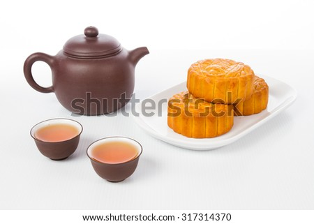 Chinese mid autumn festival with moon cake and tea pot setup in plain white background. - stock photo