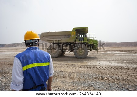 Chinese mining worker working at site - stock photo