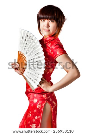 Chinese model in traditional red dress Cheongsam with slit, holding fan. Asian cute girl, young model with a variety of facial expressions and poses.