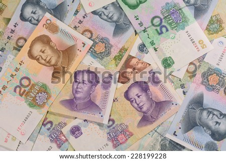 Chinese money (renminbi)  -   Yuan bank notes. Concept photo for money, banking ,currency and foreign exchange rates. - stock photo