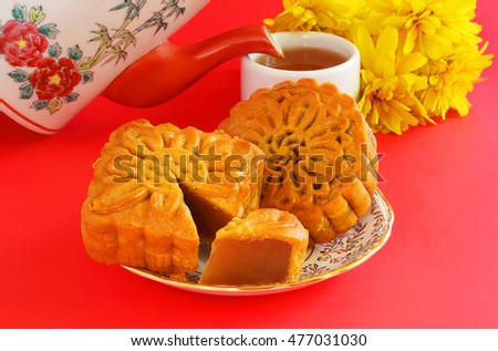 Chinese moon cakes with tea served during mid-Autumn festival