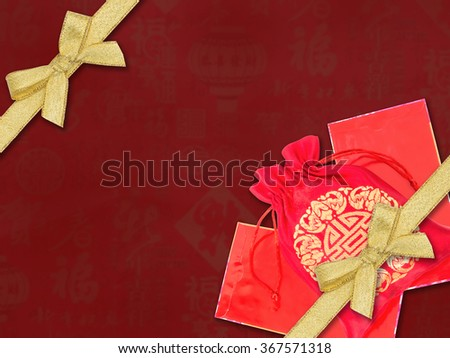 Chinese new year background.Red silky money bag lucky pouch with gold ribbon - stock photo