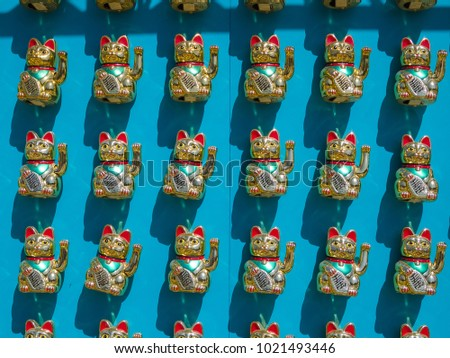 Chinese new year celebrations, beautiful waving cats.
