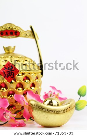Chinese New Year Decoration—Chinese gold ingots and gold pot with copy space