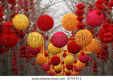 Chinese New Year Decorations, Ditan Park, Beijing, China.  During Lunar New Year, many parks and temples in China have large outdoor fairs, festivals. - stock photo
