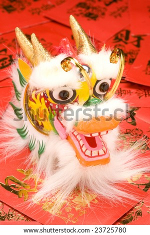 Chinese New Year Dragon Decoration on red envelopes. - stock photo