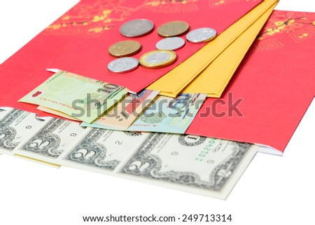 Chinese New Year festival decoration isolated on white background. Red envelopes (tien li xi vietnamese) are lucky money, typically given to children and elder during Chinese New Year for blessing. - stock photo