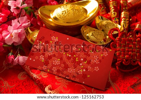 Chinese new year festival decorations, ang pow or red packet and gold ingots.