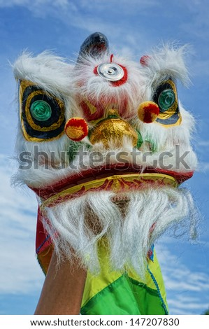 Chinese new year  lion dance with blue sky - stock photo
