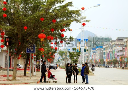 Chinese new year of Jingxi, a Chinese county with Vietnamese style, located at the border of China and Vietnam. 99% of the local people are Zhuang ethnic (Tay, nung ethnic in Vietnam) people.