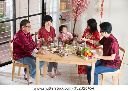 Chinese new year reunion dinner, part of Chinese culture to gather during eve - stock photo