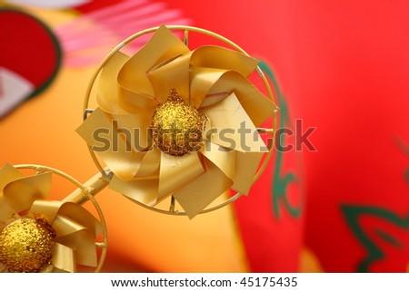 chinese new year scene, golden windmill - stock photo