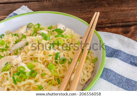 Chinese noodles, fast but delicious food with chopsticks - stock photo