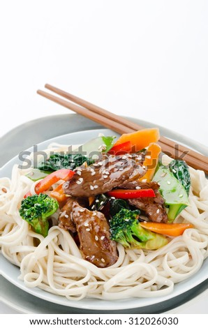Chinese noodles with beef strips and stir fried vegetables, oriental cuisine