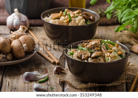Chinese noodles with brown mushrooms, simple and delicious fast food. - stock photo