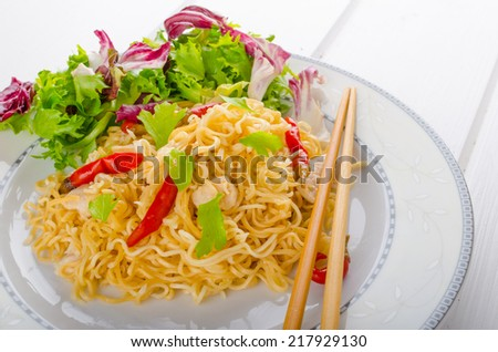 Chinese noodles with chicken chilli and fresh salad - stock photo