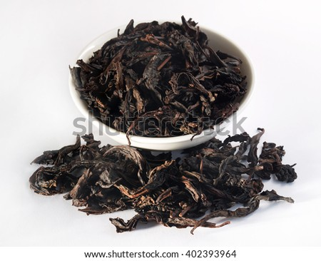 Chinese oolong tea Da Hong Pao, Big Red Robe, on white background  - stock photo
