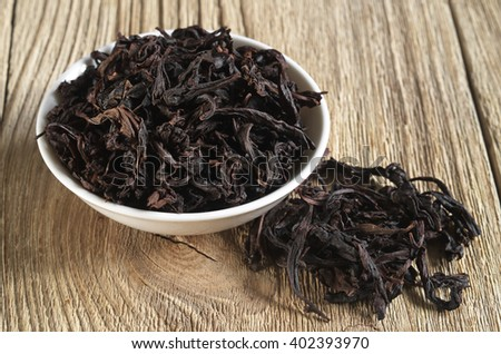 Chinese oolong tea Da Hong Pao, Big Red Robe, on wooden background  - stock photo