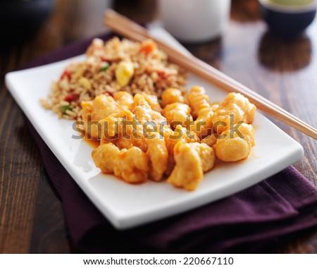 chinese orange chicken with fried rice - stock photo
