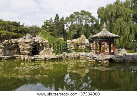 Chinese park with lake and pavilion - stock photo