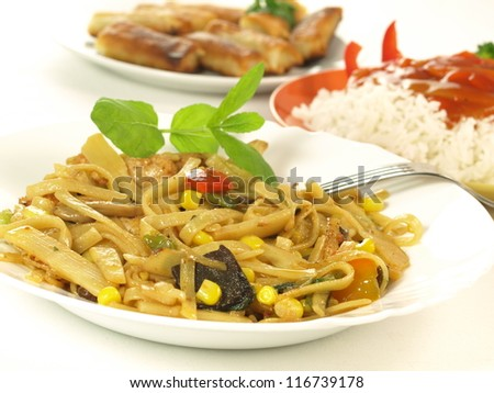 Chinese pasta, rice with sauce and Spring Rolls - stock photo