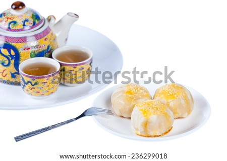 Chinese pastry or moon cake on dish and teapot set, Traditional delicious cake in asia, shot in studio, isolated on white background - stock photo