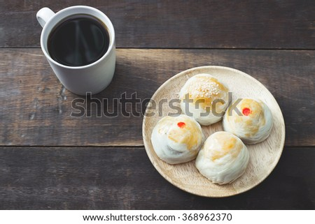 chinese pastry with hot black coffee, still life and vintage tone - stock photo