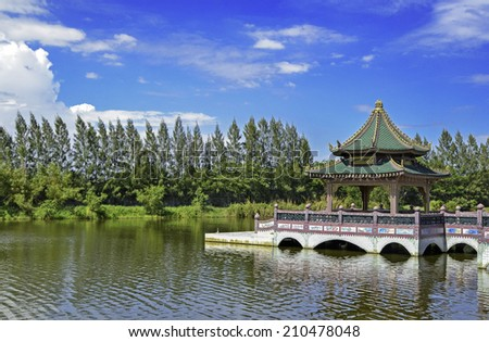 chinese pavilion in lake and blue sky   - stock photo