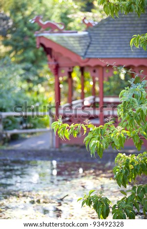Chinese pavilion  near the pond in classical chinese garden in Edinburgh Botanical Garden