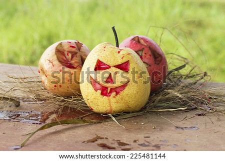 Chinese pear and apple for halloween green background - stock photo