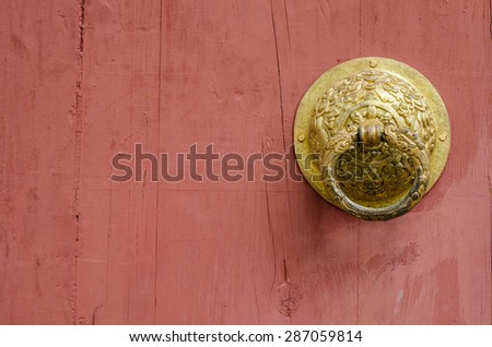 Chinese red door and knocker in gold to symbolize. - stock photo