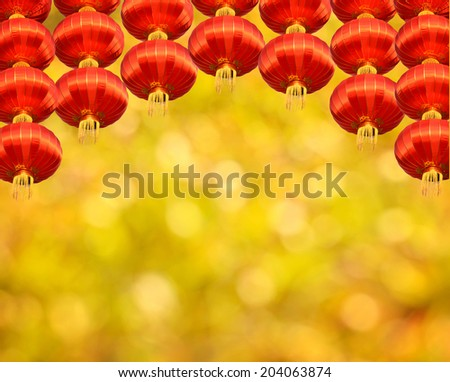 Chinese red lantern decoration in yellow background   - stock photo