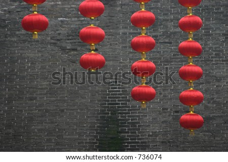 chinese red lanterns against grey wall - stock photo