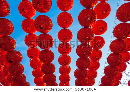 Chinese red lanterns hanging at street for decoration during the Chinese New Year festival at Chinatown, Ratchaburi, Thailand  Red lamps decoration with blue sky