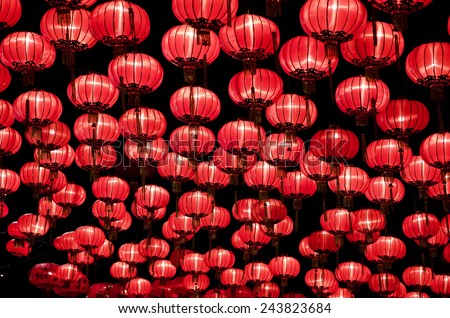 Chinese red lanterns hanging  in street at night during the Chinese New Year - stock photo