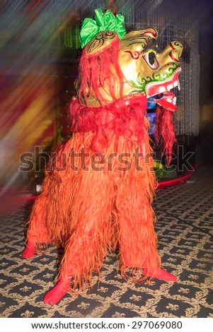 chinese red lion dance at new year day - stock photo
