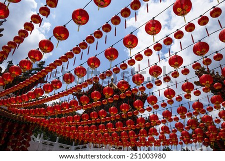 Chinese red paper lanterns decorate  Chinese temple for upcoming Chinese New Year. - stock photo