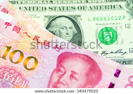 Chinese Renminbi and US dollar - stock photo